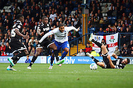 Leon Clarke of Bury looks to power his way past the Wigan defence. Skybet football league one match , Bury v Wigan Athletic at the JD Stadium in Bury, Lancs on Saturday 10th October 2015.<br /> pic by Chris Stading, Andrew Orchard sports photography.