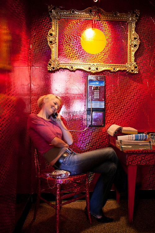 The phone booth at the Flying M, a funky coffee shop with an old cigarette vending machine, called the Art-O-Mat, that now dispenses artwork.