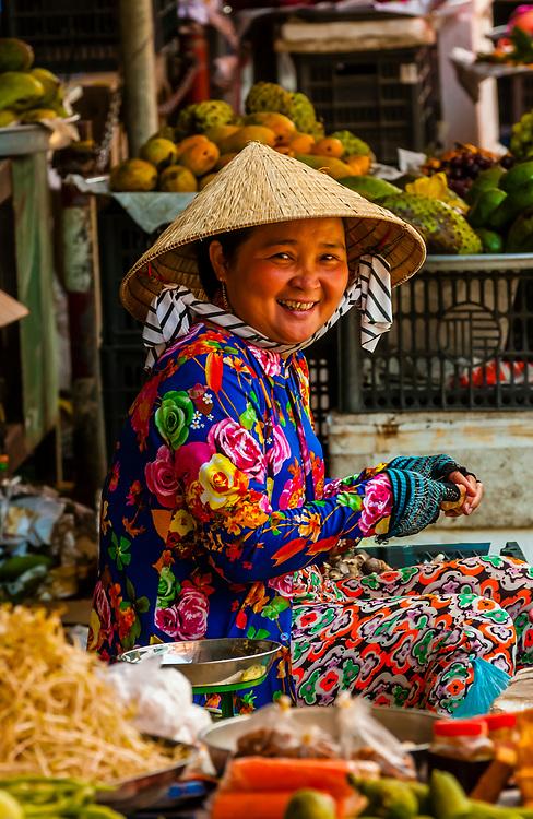 Woman at roadside vegetable market, near Cai Lay, Mekong Delta, Vietnam.