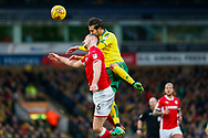 Norwich City midfielder Marco Vrancic (8) heads the ball Barnsley defender Liam Lindsay (6) defending during the EFL Sky Bet Championship match between Norwich City and Barnsley at Carrow Road, Norwich, England on 18 November 2017. Photo by Phil Chaplin.