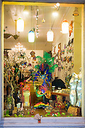 Ornate Mardi Gras masks, souvenirs and gifts in shop window in Royal Street, French Quarter of New Orleans, USA