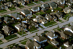 Aerial view of streets and homes in a Houston, Texas suburban neighborhood