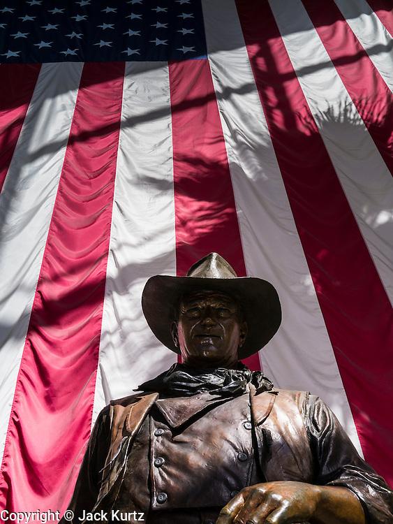 26 JUNE 2012 - ORANGE COUNTY, CALIFORNIA: A statue of John Wayne in the lobby of the John Wayne Airport in Santa Ana, Orange County, California.      PHOTO BY JACK KURTZ