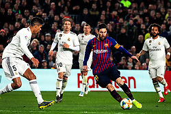 BARCELONA, Feb. 7, 2019  FC Barcelona's Lionel Messi (2nd R) breaks through during the Spanish King's Cup semifinal first leg match between FC Barcelona and Real Madrid in Barcelona, Spain, on Feb. 6, 2019. The match ended with a 1-1 draw. (Credit Image: © Joan Gosa/Xinhua via ZUMA Wire)