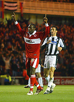 15/12/2004 - UEFA Cup, Group E - Middlesbrough v FK Partizan - The Riverside, Middlesbrough<br />Middlesbrough's Joseph_Desire Job celebratesin front of the home fans, and FK Partizan Belgrade's Nenad Djordjevic, after scoring the second goal of the evening.<br />Photo:Jed Leicester/Back Page Images