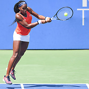 COCO GAUFF hits a backhand at the Rock Creek Tennis Center.