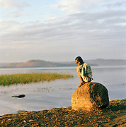 Portrait of young local boy sitting by Lake Tana, North West Ethiopia