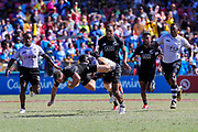 Kurt Baker gets some air in a tackle during Day 3 of the HSBC World Rugby Sevens, Mens Semi Final match between New Zealand and Fiji, 2019, Spotless Stadium, Saturday 3rd February 2019. Copyright Photo: David Neilson / www.photosport.nz
