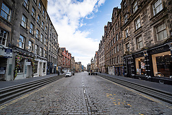 Edinburgh, Scotland, UK. 29 March, 2020. Life in Edinburgh on the first Sunday of the Coronavirus lockdown. Streets deserted, shops and restaurants closed, very little traffic on streets and reduced public transport. Pictured; The Royal Mile at Lawnmarket  Iain Masterton/Alamy Live News