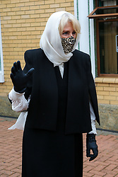 © Licensed to London News Pictures. 07/04/2021. London, UK. Camilla, Duchess of Cornwall, wearing a protective face and  and headscarf, waves as she leaves after a visit to the London Islamic Cultural Society and Mosque (also known as Wightman Road Mosque) in Haringey, north London. The Mosque was formed by a small group of Guyanese Muslims and now supports over 30 different nationalities and community in Haringey and surrounding boroughs. Photo credit: Dinendra Haria/LNP