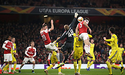 Arsenal's Sokratis Papastathopoulos (centre) scores his side's third goal of the game during the UEFA Europa League round of 32 second leg match at the Emirates Stadium, London.