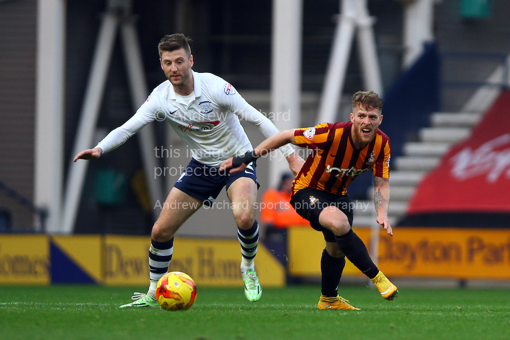 Preston North End's Paul Gallagher (l) and Bradford City's Billy Clarke battle for the ball. Skybet football league one match, Preston North End v Bradford city at Deepdale in Preston, Lancs on Saturday 15th November 2014.<br /> pic by Chris Stading, Andrew Orchard sports photography.