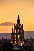 Sunset over the iconic Parroquia de San Miguel Arcangel in the historic center of San Miguel de Allende, Guanajuato, Mexico.