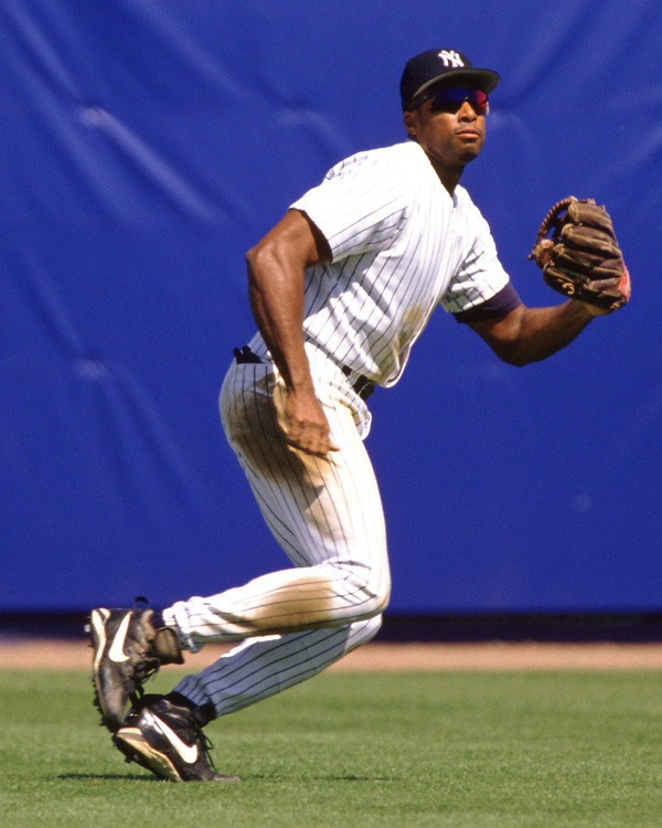 BRONX, NY - 1998: Bernie Williams of the New York Yankees fields during an MLB game at Yankee Stadium during the 1998 season.  (Photo by Ron Vesely) Subject:   Bernie Williams