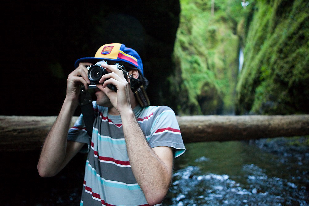 Hamilton Boyce takes pictures with his film camera in Oneonta Gorge,  a mossy slot canyon cut into the bedrock in Oregon's Columbia River Gorge National Scenic Area.