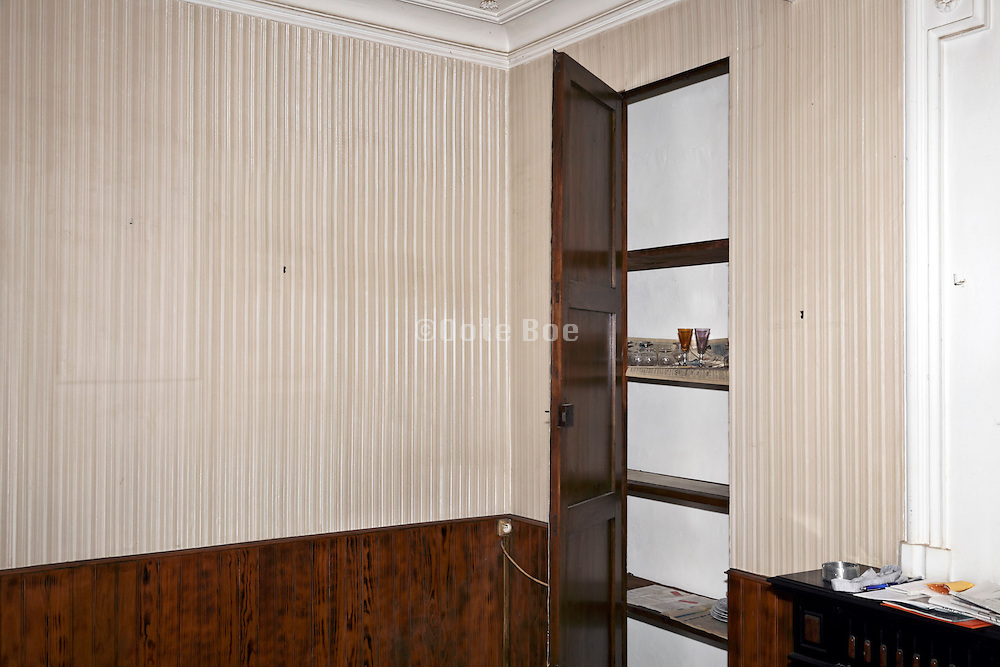 corner in abandoned house with an empty closet open