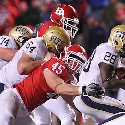 Oct 16, 2009; Piscataway, NJ, USA; Rutgers defensive end Alex Silvestro (45) tackles Pittsburgh running back Dion Lewis (28) during second half NCAA football action in Pittsburgh's 24-17 victory over Rutgers at Rutgers Stadium.