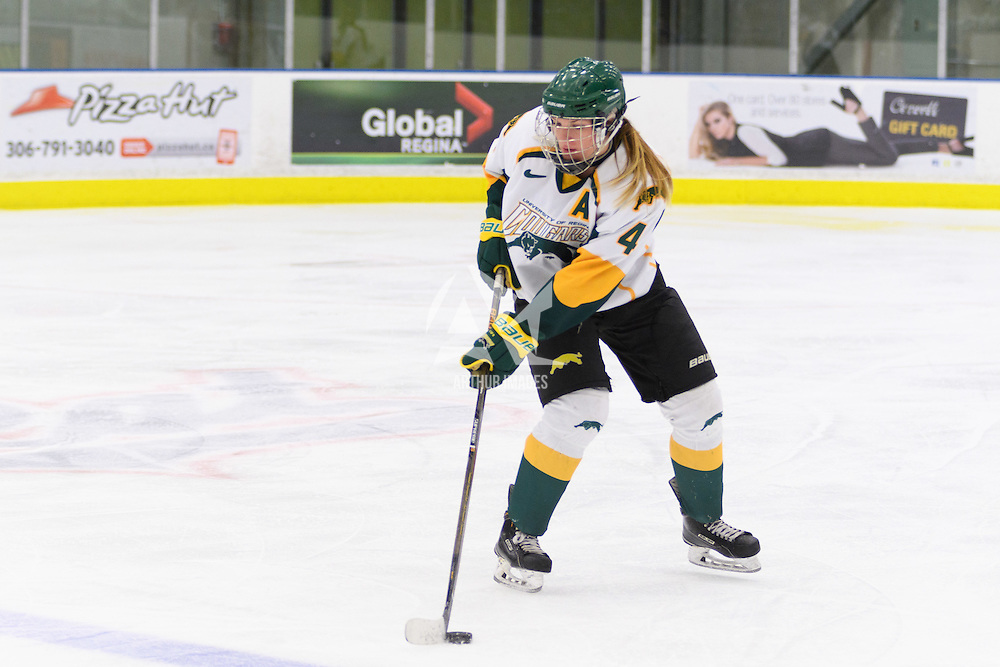 5th year defender Krista Metz (4) of the Regina Cougars in action during the Women's Hockey Home Game on October 15 at Co-operators arena. Credit: Arthur Ward/Arthur Images