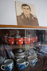 A photograph of Nina Morozova's son takes pride of place in her apartment. Her son, serving in the Russian army, is unable to visit her since the conflict in Ukraine began.