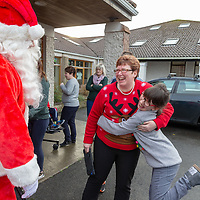 Deirdre O'Gorman and Casey Diviney from Shannon meet Santa at St Clares School
