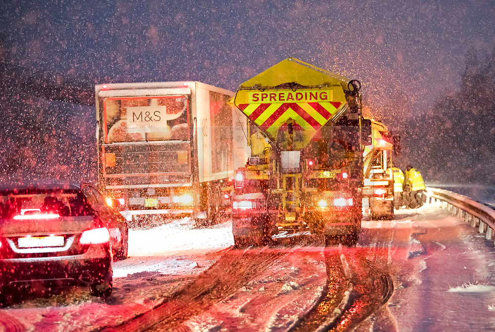 © Licensed to London News Pictures. 10/12/2017. Bourne End, UK. A glitter is used to attempt to rescue a car which has spun on the road in heavy snowfall on the A41 near Bourne End in Buckinghamshire as parts of the south east of England are blanketed with snow for the first time this winter. Photo credit: Ben Cawthra/LNP