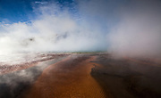 The Grand Prismatic Spring erupts color in to the steam of a cold winter morning.<br /> <br /> Photo by David Stubbs <br /> www.davidstubbs.com<br /> www.avivideye.com