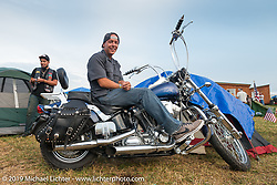 Back camping area of the Sturgis Buffalo Chip during the annual Black Hills Motorcycle Rally. SD, USA. August 6, 2014.  Photography ©2014 Michael Lichter.