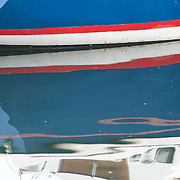 Reflection os boat hulls in Gloucester, MA harbor on Cape ann
