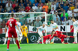Miso Brecko of Slovenia and Bostjan Cesar of Slovenia vs Adam Lallana of England during the EURO 2016 Qualifier Group E match between Slovenia and England at SRC Stozice on June 14, 2015 in Ljubljana, Slovenia. Photo by Vid Ponikvar / Sportida