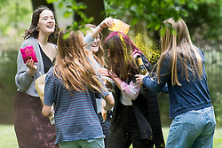 © Licensed to London News Pictures. 04/06/2021. Oxford, UK. Students at Oxford University celebrate finishing their final exams with the tradition known as 'trashing'. Oxford University is attempting to clamp down on the tradition which sees students throwing food, confetti and drink over their classmates. Photo credit: Ben Cawthra/LNP