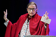 U.S. Supreme Court Justice Ruth Bader Ginsburg gestures to students before she speaks at Amherst College in Amherst, Mass., Thursday, Oct. 3, 2019. (AP Photo/Jessica Hill)