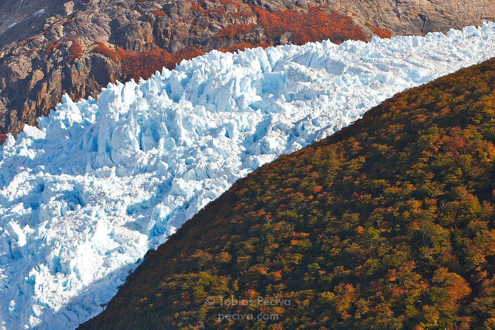 A glacier separates two colorful mountainsides in Los Glaciares National Park, Argentina.
