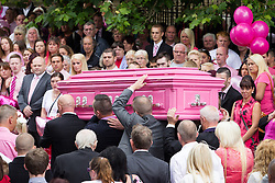 © Licensed to London News Pictures . 09/08/2013 . Salford , UK . The pink coffin is carried in to the church . The funeral of Linzi Ashton at St Paul's C of E Church in Salford , today (9th August 2013) . Linzi Ashton (25) was found murdered in her home on Westbourne Road in Salford on 29th June . Michael Cope is standing trial, accused of murdering, raping and assaulting her . Photo credit : Joel Goodman/LNP