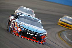 March 10, 2018 - Avondale, Arizona, United States of America - March 10, 2018 - Avondale, Arizona, USA: Kyle Busch (18) brings his car through the turns during the DC Solar 200 at ISM Raceway in Avondale, Arizona. (Credit Image: © Chris Owens Asp Inc/ASP via ZUMA Wire)