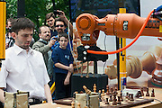 Moscow, Russia, 19/05/2012..Russian grandmaster and former World Blitz Chess Champion Alexander Grischuk loses a knight as he heads to defeat against the German-built KUKA Monster chess robot. The match was a warm up before the main contest between KUKA Monster and Russia?s CHESSka robot for the title of Absolute World Robot Chess Champion. KUKA Monster easily beat the human Russian grandmaster, but was in turn comprehensively defeated by the Russian robot.