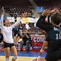 Navajo Prep's Cienna Harrison (1) celebrates with the team as they win a point against Tularosa Friday morning at the Santa Ana Star Center in the NMAA Class 3A State Volleyball tournament in Rio Rancho. Navajo Prep Eagles swept the Tularosa Wildcats in straight sets.