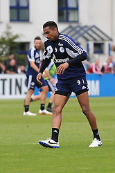 24.04.2014, Veltins Arena, Gelsenkirchen, GER, 1. FBL, Training Schalke 04, im Bild Kevin Prince Boateng ( Schalke 04 ) hat vor Wut sein Trainingsleibchen weggeworfen und humpelt nach einem Tritt mit schmerzverzehrtem Gesicht. // during a Trainingsession of German Bundesliga Club Schalke 04 at the Veltins Arena in Gelsenkirchen, Germany on 2014/04/24. EXPA Pictures © 2014, PhotoCredit: EXPA/ Eibner-Pressefoto/ Thienel<br /> <br /> *****ATTENTION - OUT of GER*****