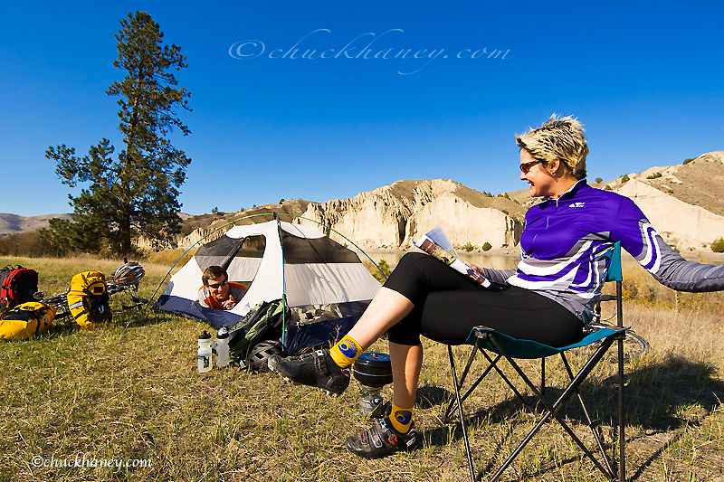 Bicycle tourists at campsite in the Mission Valley of Montana model released