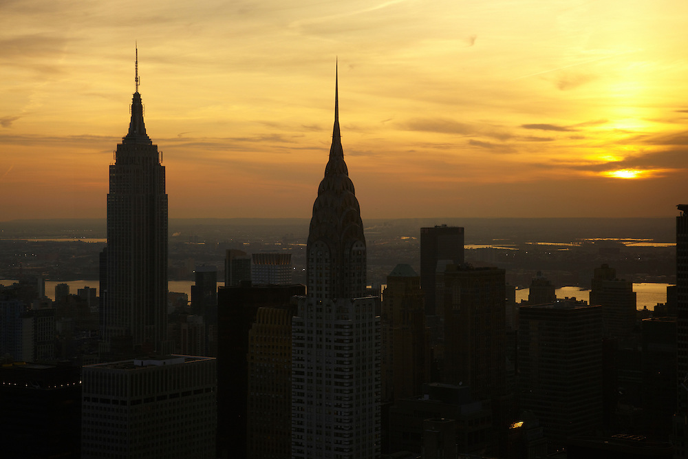 Sunset view of the Empire State Building and Chrysler Building from 845 UN Plaza, 90th floor