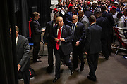 Republican presidential candidate Donald Trump departs after signing autographs and shaking hands at the conclusion of a campaign rally at the Tampa Convention Center in Tampa, Florida, June 11, 2016.