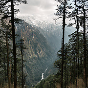 View over the Mo Chuu river. The rough dirt road leading to the end of the road before trekking up to Laya village.