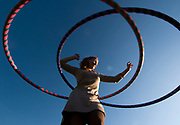 NEWS&GUIDE PHOTO / PRICE CHAMBERS<br /> Emily Brumsted begins teaching a hula hooping class on October 5 at Center for the Arts. The self-taught hula hooper is structuring the class to include a fitness component and some dancing.