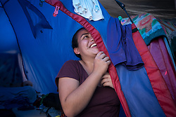 A young woman from El Salvador is among around 2,000 people appealing for asylum in the US who are now camped at El Chaparral, Tijuana
