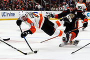 Philadelphia Flyers defenseman Ivan Provorov (L) dives for the puck against Anaheim Ducks during a 2017-2018 NHL hockey game in Anaheim, California, the United States, on Oct. 7, 2017. Philadelphia Flyers won 3-2 in overtime.
