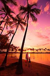 Mother and child walking, Anaehoomalu or `Anaeho`omalu Beach at sunset, Waikoloa, Big Island, Hawaii, Pacific Ocean