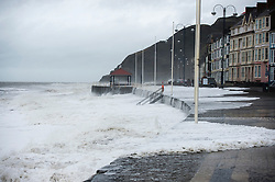 © Licensed to London News Pictures. 27/01/2016. Aberystwyth, UK.  Large waves crash against the west coast at Aberystwyth in wales at high tide. The tail end of storm Jonas continues to hit the UK, bringing torrential rain and galesPhoto credit: Keith Morris/LNP