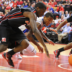 Rutgers Scarlet Knights guard Eli Carter (5), Rutgers forward Kadeem Jack (22) and Seton Hall Pirates guard/forward Fuquan Edwin (23) dive for a loose ball during first half Big East NCAA Basketball between the Rutgers Scarlet Knights and Seton Hall Pirates at the Louis Brown Athletic Center. Rutgers leads Seton Hall 28-26 at halftime.