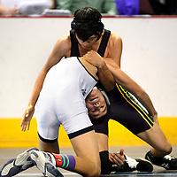 022114  Adron Gardner/Independent<br /> <br /> Newcomb Skyhawk Juwaun Charles avoids a shoot by Silver City Colt Vinnie Vega during the state wrestling championship at the Santa Ana Star Center in Rio Rancho Friday.