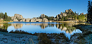 Sylvan Lake reflections. Custer State Park and wildlife reserve in the Black Hills, in Custer County, South Dakota, USA. South Dakota's largest and first state park was named after Lt. Colonel George Armstrong Custer. This image was stitched from multiple overlapping photos.