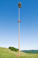 German Maypole typical of the Franconia region stands on Walberla hill, Franconian Switzerland, Germany